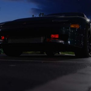 My VR4 in a parking lot in the evening.